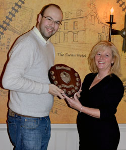 Simon Evans awarding Angela Graham of The Swan Hotel the award.
